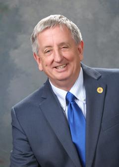 Former State Representative James E. Smith (R)