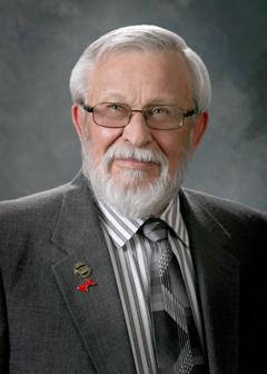 Former State Representative Ernest H. Chavez (D)
